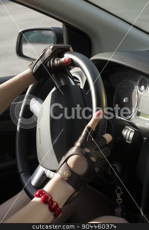 Driving girl stock photo, Driving girl with hands on wheel steering by Aikon