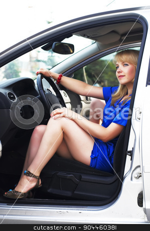 attractive blonde woman driver stock photo, Attractive blonde woman driver seated behind the wheel by Aikon