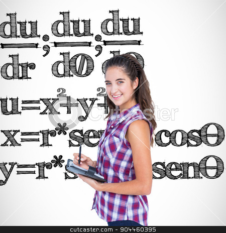 Composite image of pretty brunette writing on notebook  stock photo, Pretty brunette writing on notebook  against math equation by Wavebreak Media