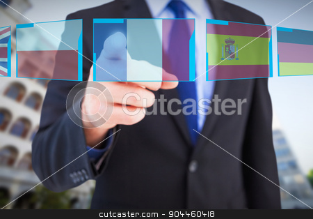 Composite image of businessman pointing his finger at camera stock photo, Businessman pointing his finger at camera against blue interface by Wavebreak Media