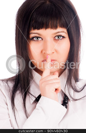 Woman gesturing to silence stock photo, Young woman showing gesture