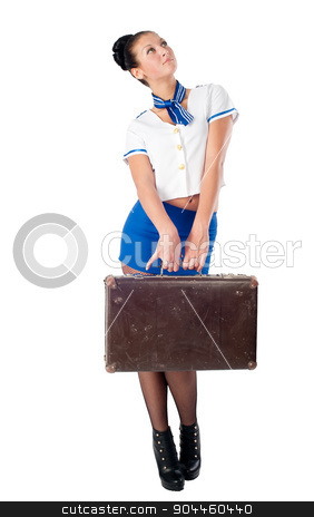 Young beautiful air hostess stock photo, Attractive young stewardess with old-fashioned suitcase. Isolated on white by Aikon