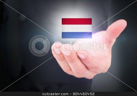 Composite image of businessman holding out his hand stock photo, Businessman holding out his hand against blue background with vignette by Wavebreak Media