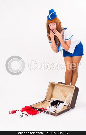 Young beautiful air hostess stock photo, Attractive young stewardess with old suitcase at white background by Aikon