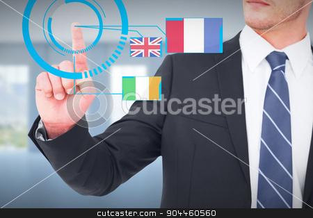 Composite image of unsmiling businessman pointing his finger stock photo, Unsmiling businessman pointing his finger against room overlooking ocean by Wavebreak Media