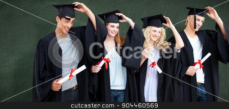 Composite image of group of teenagers celebrating after graduati stock photo, Group of teenagers celebrating after Graduation against green chalkboard by Wavebreak Media