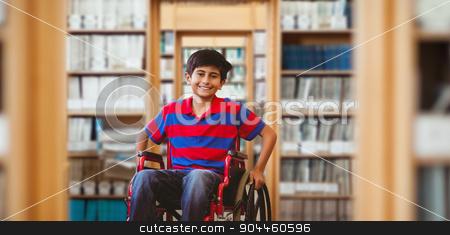 Composite image of boy sitting in wheelchair in school corridor stock photo, Boy sitting in wheelchair in school corridor against library by Wavebreak Media
