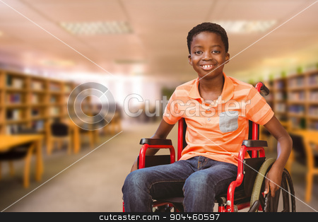 Composite image of portrait of boy sitting in wheelchair at libr stock photo, Portrait of boy sitting in wheelchair at library against view of library by Wavebreak Media