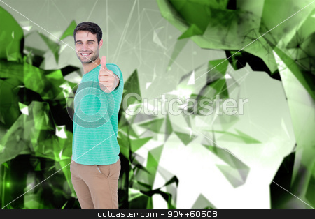 Composite image of portrait of smiling handsome man gesturing th stock photo, Portrait of smiling handsome man gesturing thumbs up against angular design by Wavebreak Media