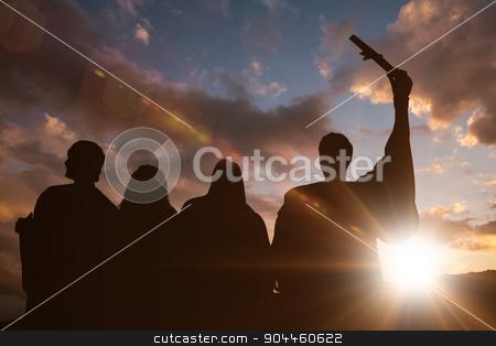 Composite image of silhouette of graduate stock photo, Silhouette of graduate against sun shining by Wavebreak Media