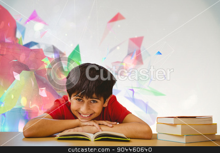 Composite image of portrait of boy reading book in library stock photo, Portrait of boy reading book in library against colourful abstract design by Wavebreak Media