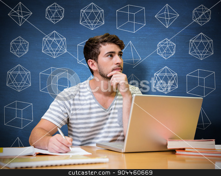 Composite image of student studying in the library with laptop stock photo, Student studying in the library with laptop against blue chalkboard by Wavebreak Media