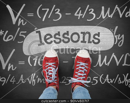 Lessons against black background stock photo, The word lessons and casual shoes against black background by Wavebreak Media