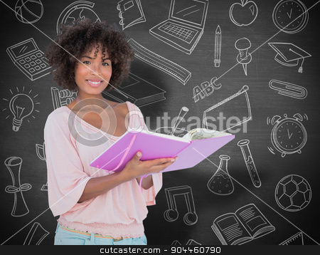 Composite image of beautiful woman holding photo album and smili stock photo, Beautiful woman holding photo album and smiling  against black background by Wavebreak Media