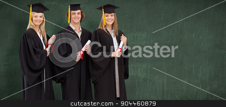 Composite image of three smiling students in graduate robe holdi stock photo, Three smiling students in graduate robe holding a diploma against green chalkboard by Wavebreak Media