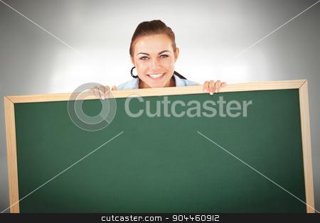 Composite image of smiling businesswoman looking over wall stock photo, Smiling businesswoman looking over wall against room overlooking city by Wavebreak Media