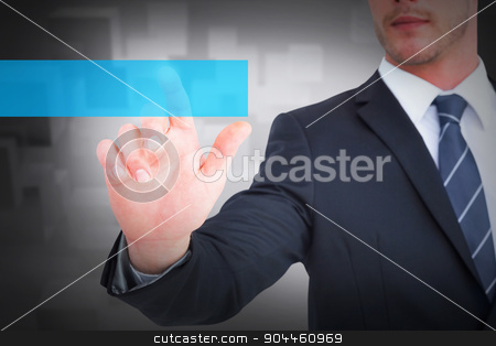 Composite image of focused businessman pointing with his finger stock photo, Focused businessman pointing with his finger against room with floating cubes by Wavebreak Media
