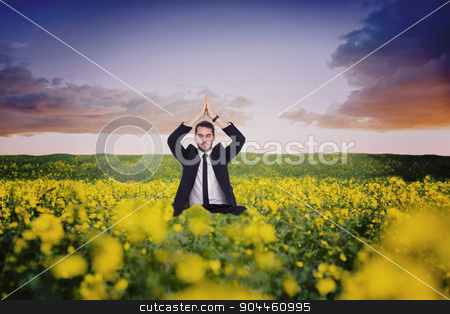 Composite image of businessman sitting in lotus pose with hands  stock photo, Businessman sitting in lotus pose with hands together against nature scene by Wavebreak Media