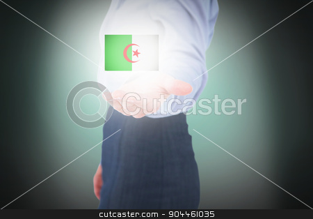 Composite image of businesswoman presenting with hand stock photo, Businesswoman presenting with hand against green background with vignette by Wavebreak Media