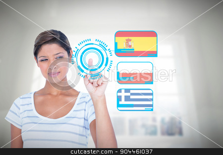 Composite image of beautiful woman touching invisible screen stock photo, Beautiful woman touching invisible screen against room overlooking city by Wavebreak Media