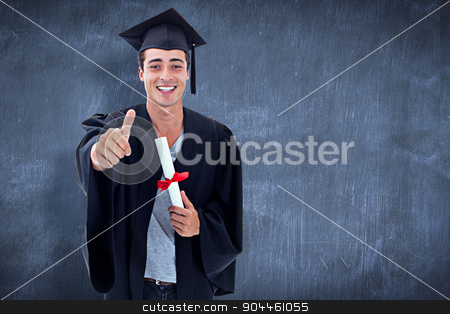 Composite image of happy teen guy celebrating graduation stock photo, Happy Teen Guy Celebrating Graduation against blue chalkboard by Wavebreak Media