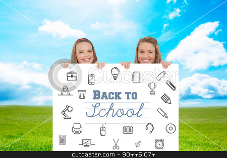 Composite image of close up of young women behind a blank sign stock photo, Close up of young women behind a blank sign against blue sky over green field by Wavebreak Media