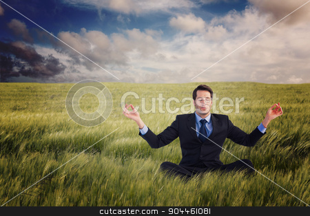 Composite image of calm businessman sitting in lotus pose stock photo, Calm businessman sitting in lotus pose against nature scene by Wavebreak Media