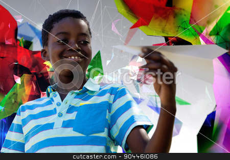 Composite image of cute little boy with paper airplane stock photo, Cute little boy with paper airplane against angular design by Wavebreak Media