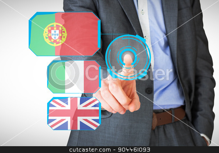 Composite image of businessman in grey suit pointing stock photo, Businessman in grey suit pointing against blue interface by Wavebreak Media