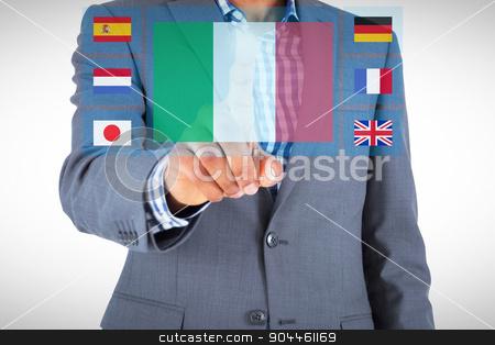 Composite image of focused businessman pointing stock photo, Focused businessman pointing against blue interface by Wavebreak Media