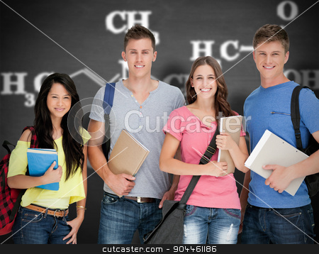 Composite image of students looking at the camera as they hold n stock photo, Students looking at the camera as they hold notepads against black background by Wavebreak Media