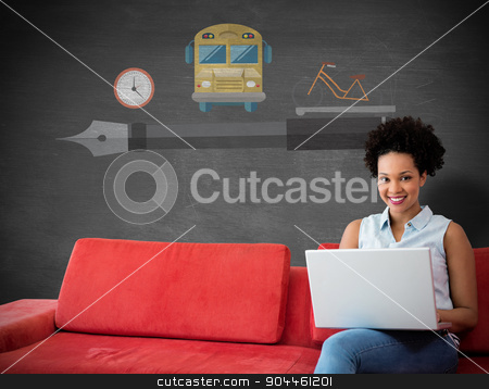 Composite image of smiling female college student using laptop w stock photo, Smiling female college student using laptop while sitting on sofa against black background by Wavebreak Media