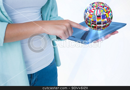 Composite image of woman using tablet pc  stock photo, Woman using tablet pc  against sphere made of flags by Wavebreak Media