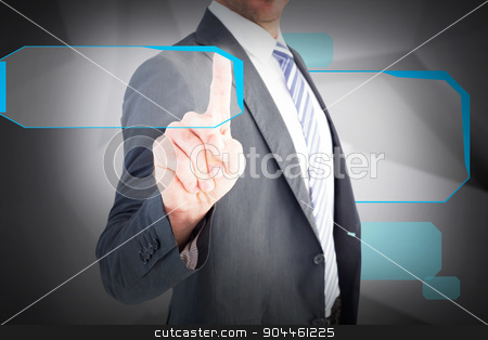 Composite image of businessman pointing with his finger stock photo, Businessman pointing with his finger against abstract grey room by Wavebreak Media
