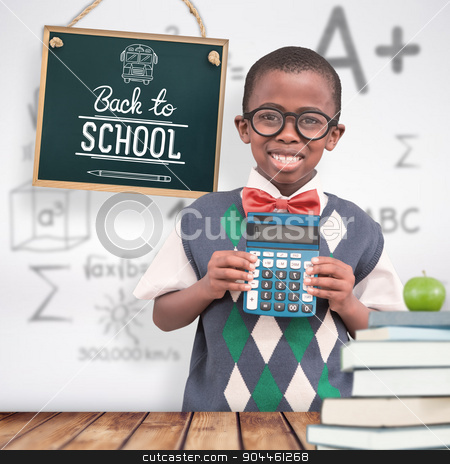 Composite image of happy pupil with calculator  stock photo, Happy pupil with calculator  against wooden planks background by Wavebreak Media