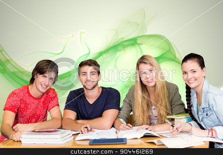 Composite image of students studying stock photo, Students studying against green abstract design by Wavebreak Media