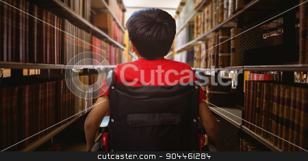 Composite image of rear view of boy sitting in wheelchair stock photo, Rear view of boy sitting in wheelchair against close up of a bookshelf by Wavebreak Media
