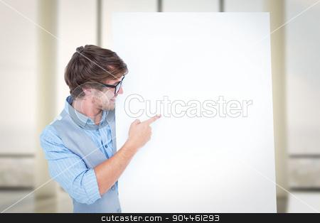 Composite image of smiling handsome man pointing at billboard stock photo, Smiling handsome man pointing at billboard against window overlooking city by Wavebreak Media