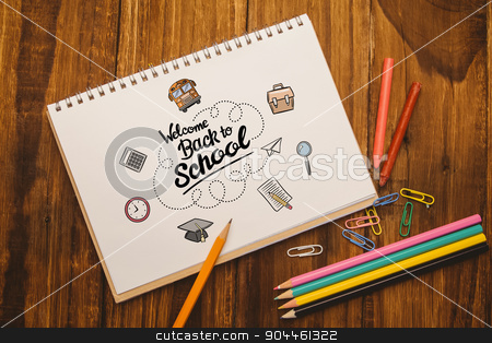 Composite image of back to school stock photo, back to school against notepad on student desk by Wavebreak Media