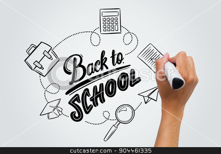 Composite image of back to school stock photo, back to school against female hand writing with marker by Wavebreak Media