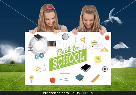 Composite image of close up of two young women holding a blank b stock photo, Close up of two young women holding a blank board against moon over field by Wavebreak Media
