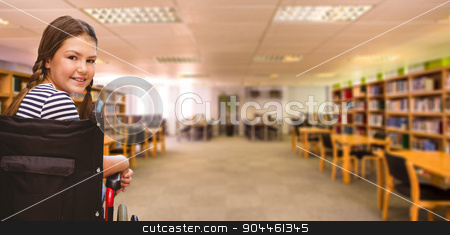 Composite image of girl sitting in wheelchair in school stock photo, Girl sitting in wheelchair in school against view of library by Wavebreak Media