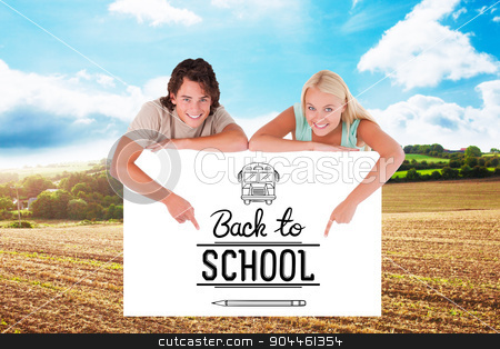Composite image of man and cute woman pointing on a whiteboard stock photo, Man and cute woman pointing on a whiteboard against blue sky over fields by Wavebreak Media