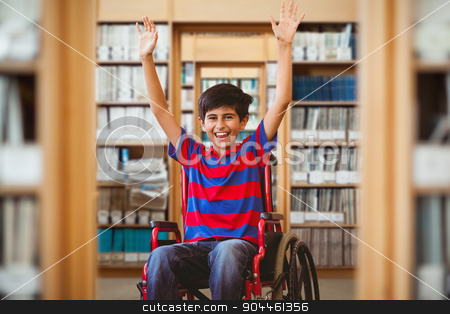 Composite image of boy in wheelchair in school corridor stock photo, Boy in wheelchair in school corridor against library by Wavebreak Media