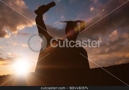 Composite image of silhouette of graduate stock photo, Silhouette of graduate against clouds by Wavebreak Media