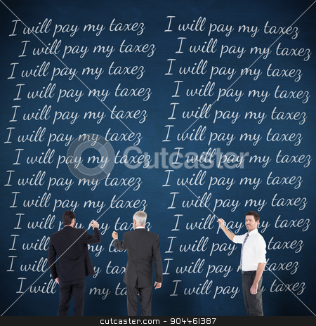 Composite image of business team writing stock photo, Business team writing against blue chalkboard by Wavebreak Media