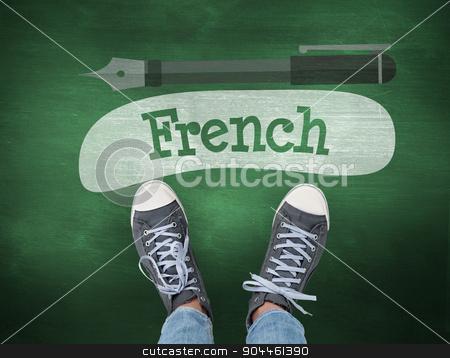 French against green chalkboard stock photo, The word french and casual shoes against green chalkboard by Wavebreak Media