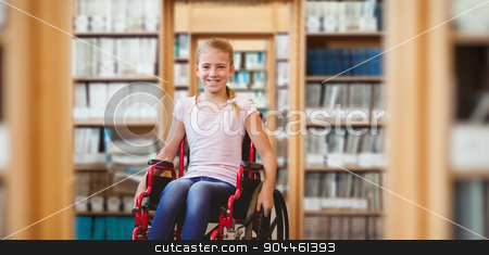 Composite image of girl sitting in wheelchair in school corridor stock photo, Girl sitting in wheelchair in school corridor against library by Wavebreak Media
