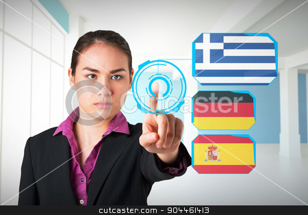Composite image of serious businesswoman pointing stock photo, Serious businesswoman pointing against modern blue and white room by Wavebreak Media