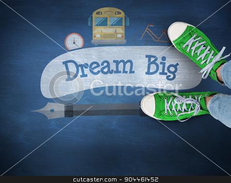 Dream big against blue chalkboard stock photo, The word dream big and casual shoes against blue chalkboard by Wavebreak Media